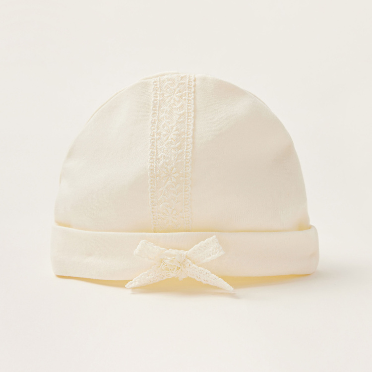 Giggles Solid Cap with Lace Detail and Bow Accent