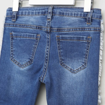 Iconic 5-Pocket Denim Jeans with Frayed Panels and Tassel Detail
