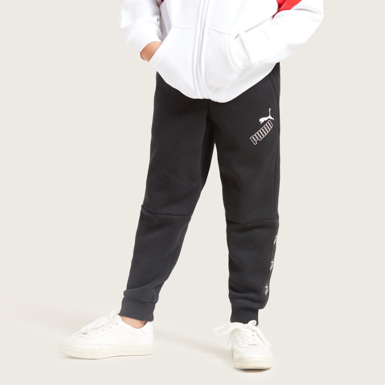 PUMA Solid Sweatpants with Elasticated Waistband and Pockets