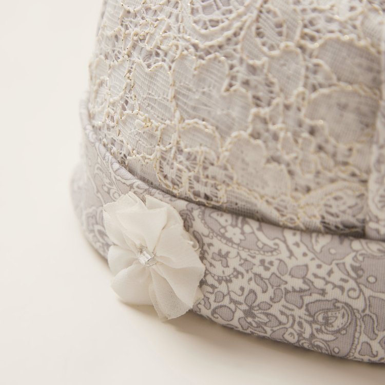 Giggles Textured Cap with Cuffed Hem and Flower Applique Detail